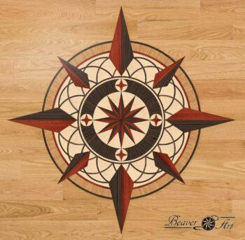 Compass in wooden floor